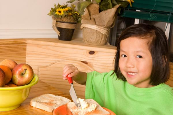 Child making toast