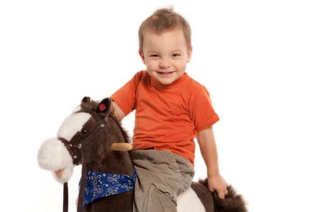 Child on rocking horse