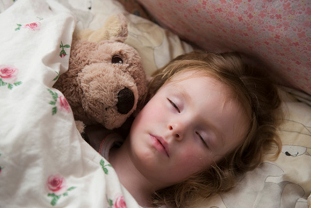 Child sleeping in bed | Sheknows.com