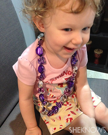 child wearing candy necklace