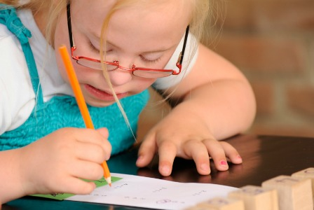 Child with Down syndrom in school