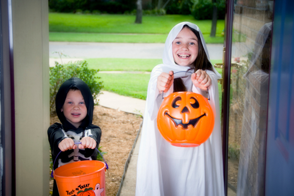Child at the door trick or treating