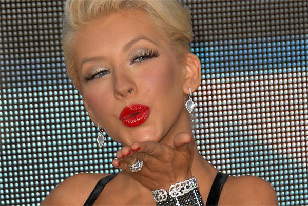 Christina Aguilera with false eyelashes and red lips