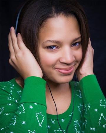 Festive woman listening to Christmas music