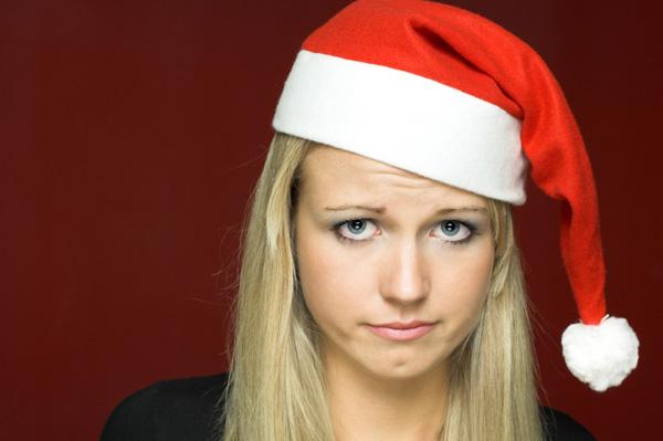 Woman sulking in santa hat