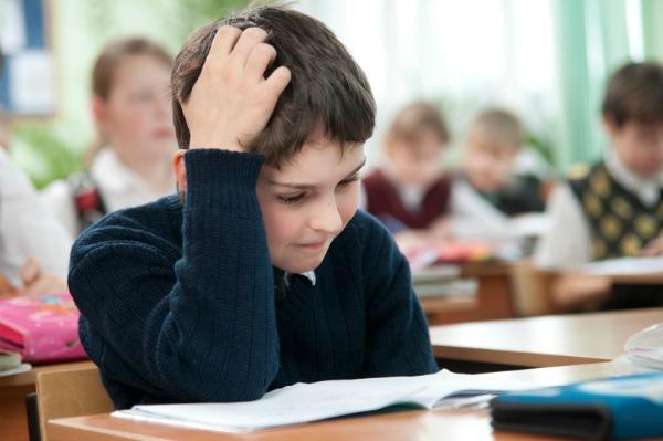 Boy taking test in school