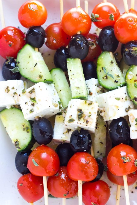 Healthy road trip snacks: greek salad skewers made with fresh tomatoes, cucumbers, feta cheese and olives.