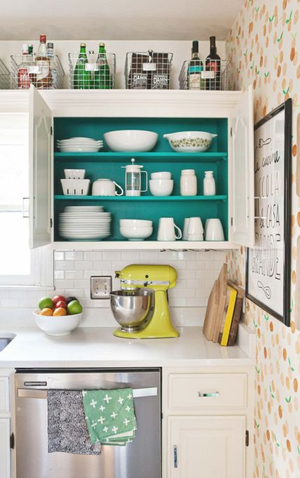 colorful kitchen with blue shelves, yellow mixer