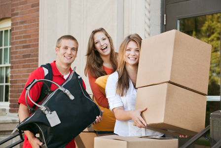college kids moving into a dorm room