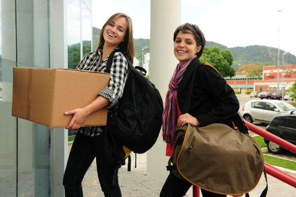 college female freshmen moving into dorms