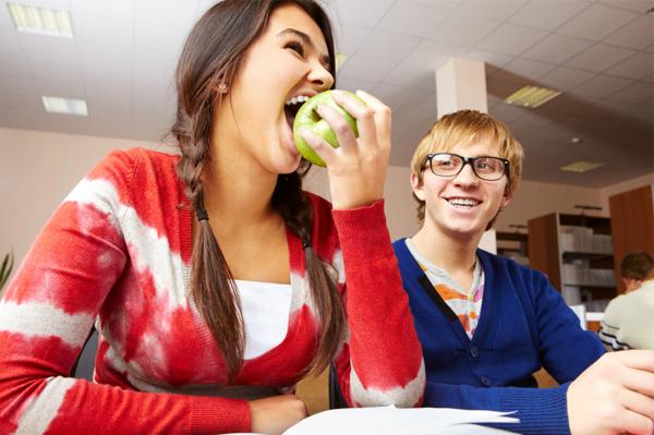 College girl eating apple