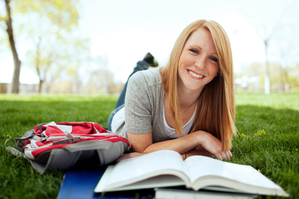 College girl studying outside