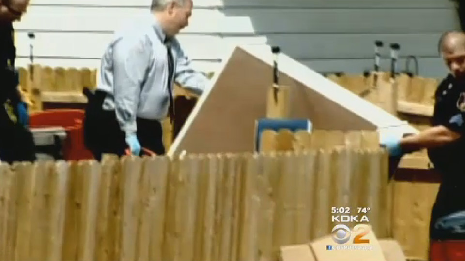 Police removing dresser from house | Sheknows.com