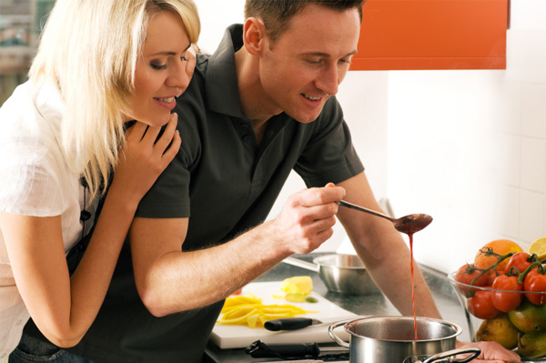 Couple cooking romantic dinner at home