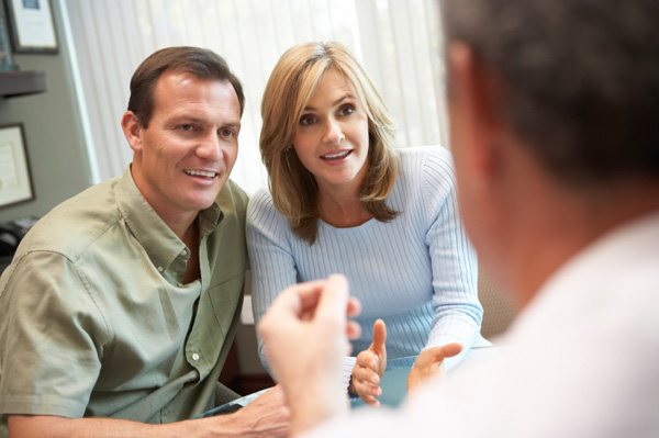 Couple discussing IVF with doctor
