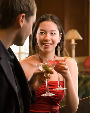 couple drinking martinis