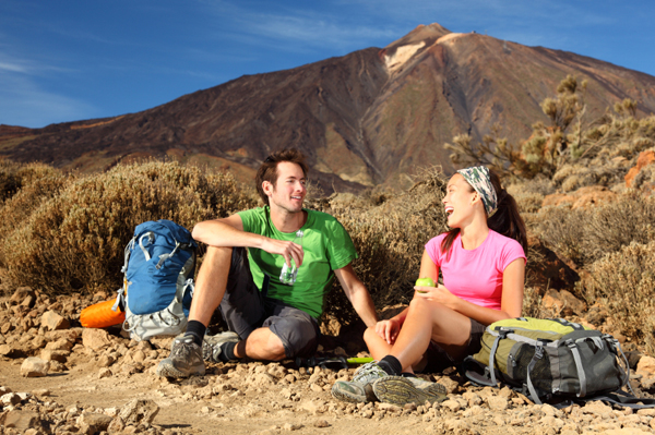Couple eating while hiking