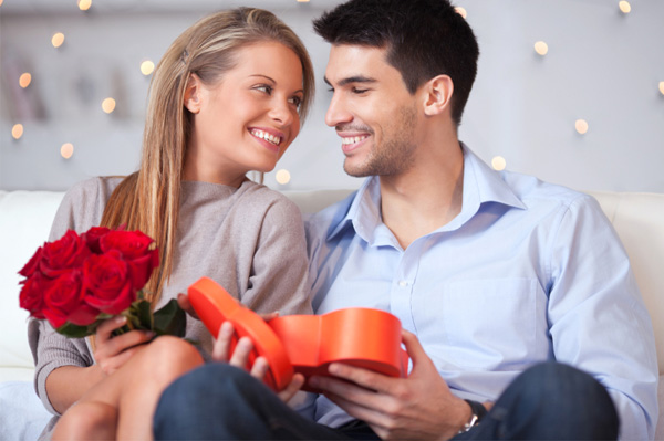 Couple exchanging vday gifts