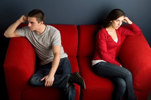 Couple fighting on couch