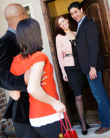 couple greeting house visitors
