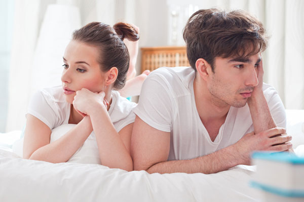 Couple having an awkward moment in bed | Sheknows.ca