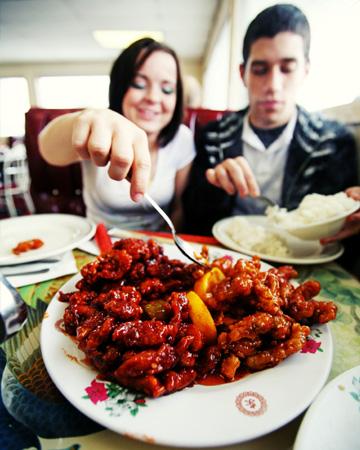 Couple having Chinese food on Christmas
