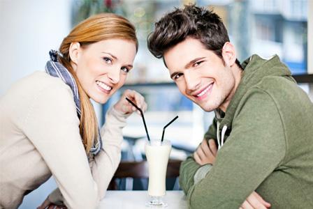 Couple having milkshakes