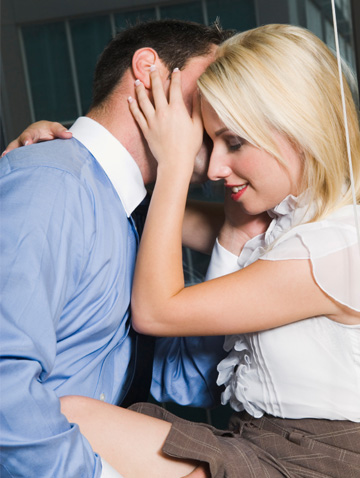 Couple having sex at work