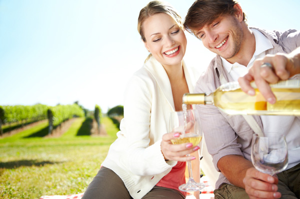 Couple having wine outdoors