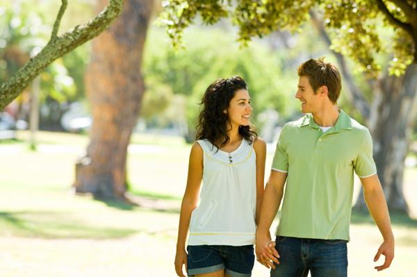 Couple walking through the park.