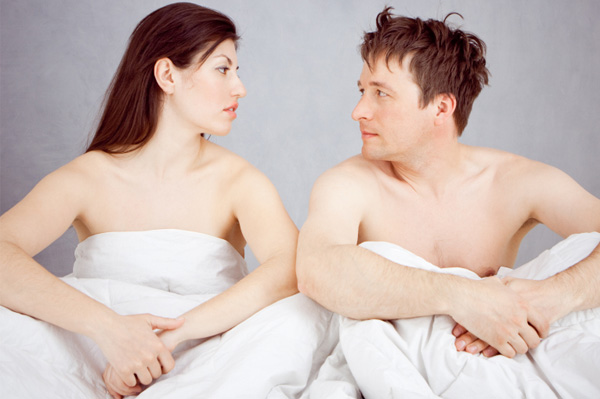 Couple looking at each other after sex