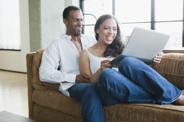 Couple on laptop together