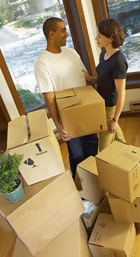man and woman with packing boxes