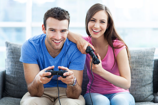 Couple playing game in man cave