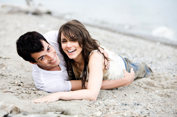 Couple rolling in sand