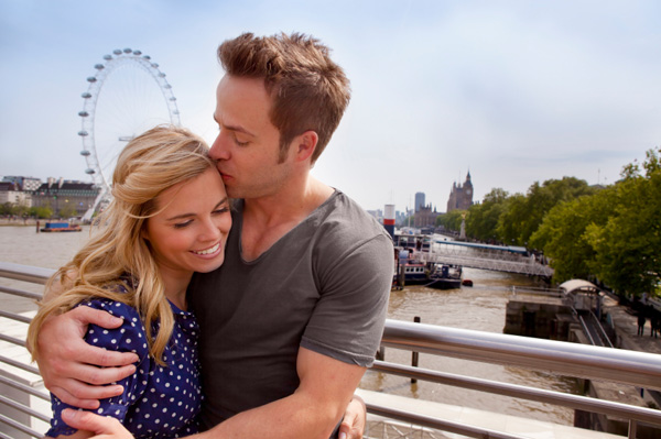 Couple in front of the London Eye