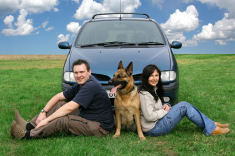 Couple traveling in car with dog