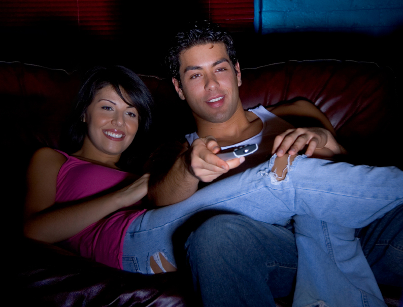 couple watching movie on couch