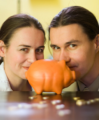 Young Couple with Piggy Bank
