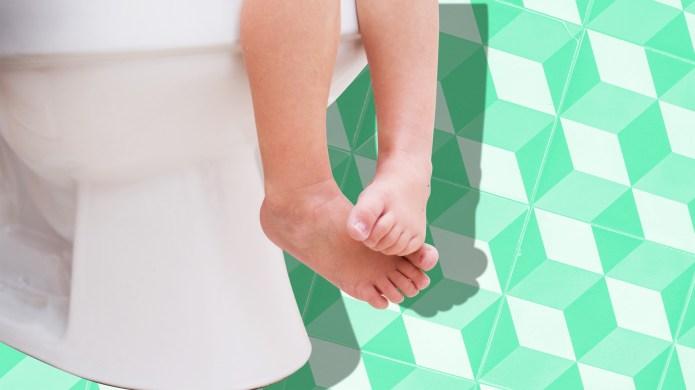 Toddler Potty Training Sitting on Toilet