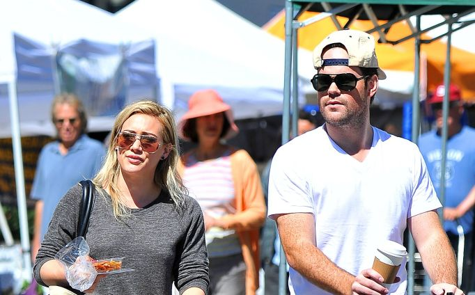 Hilary Duff and Mike Comrie out with their son.