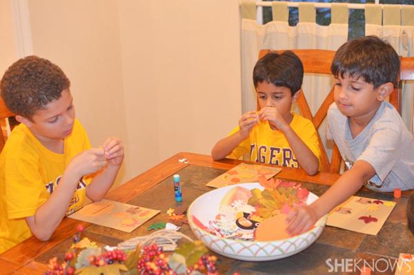 Kids making fall garland craft