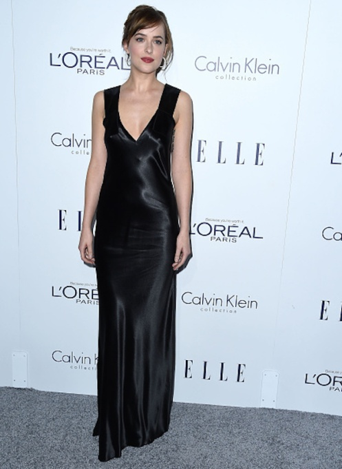 Dakota Johnson in long black silky dress