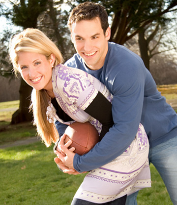 Young couple playing football