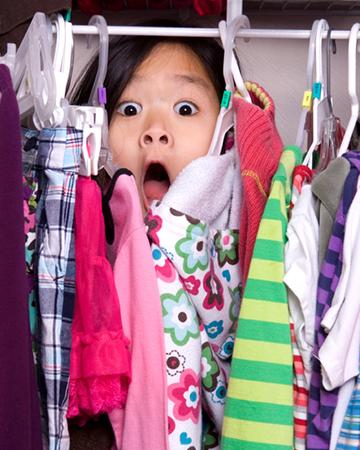 Cute girl hiding in closet | Sheknows.com