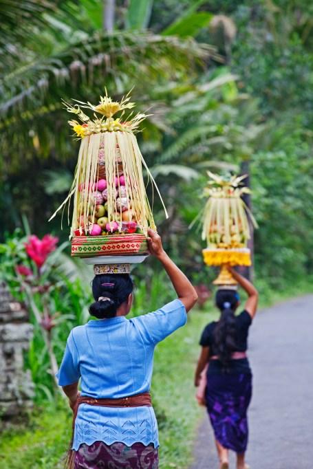 Women carrying food in Bali