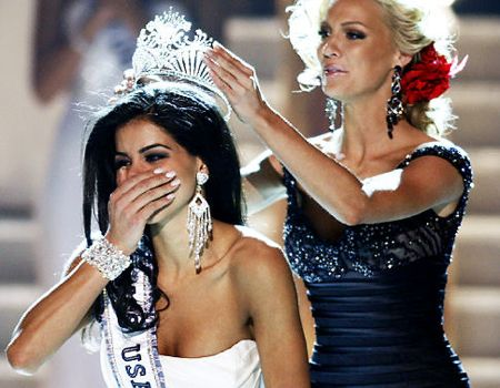 Miss Michigan Rima Fakih, left, reacts
