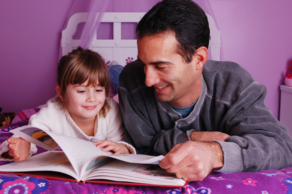 Dad reading with daughter