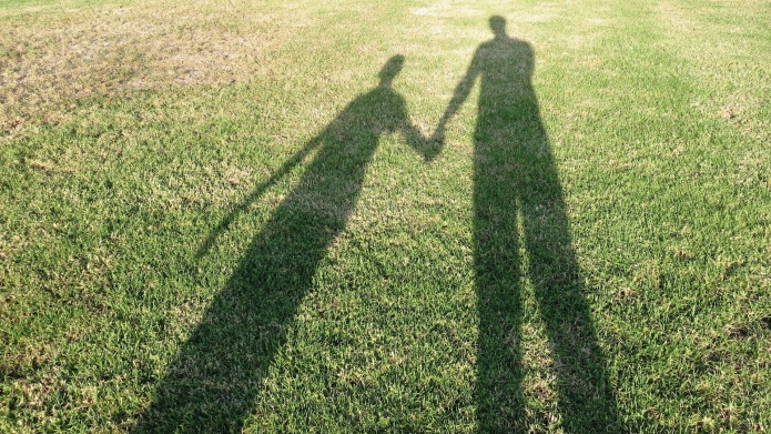 People shadow on the grass