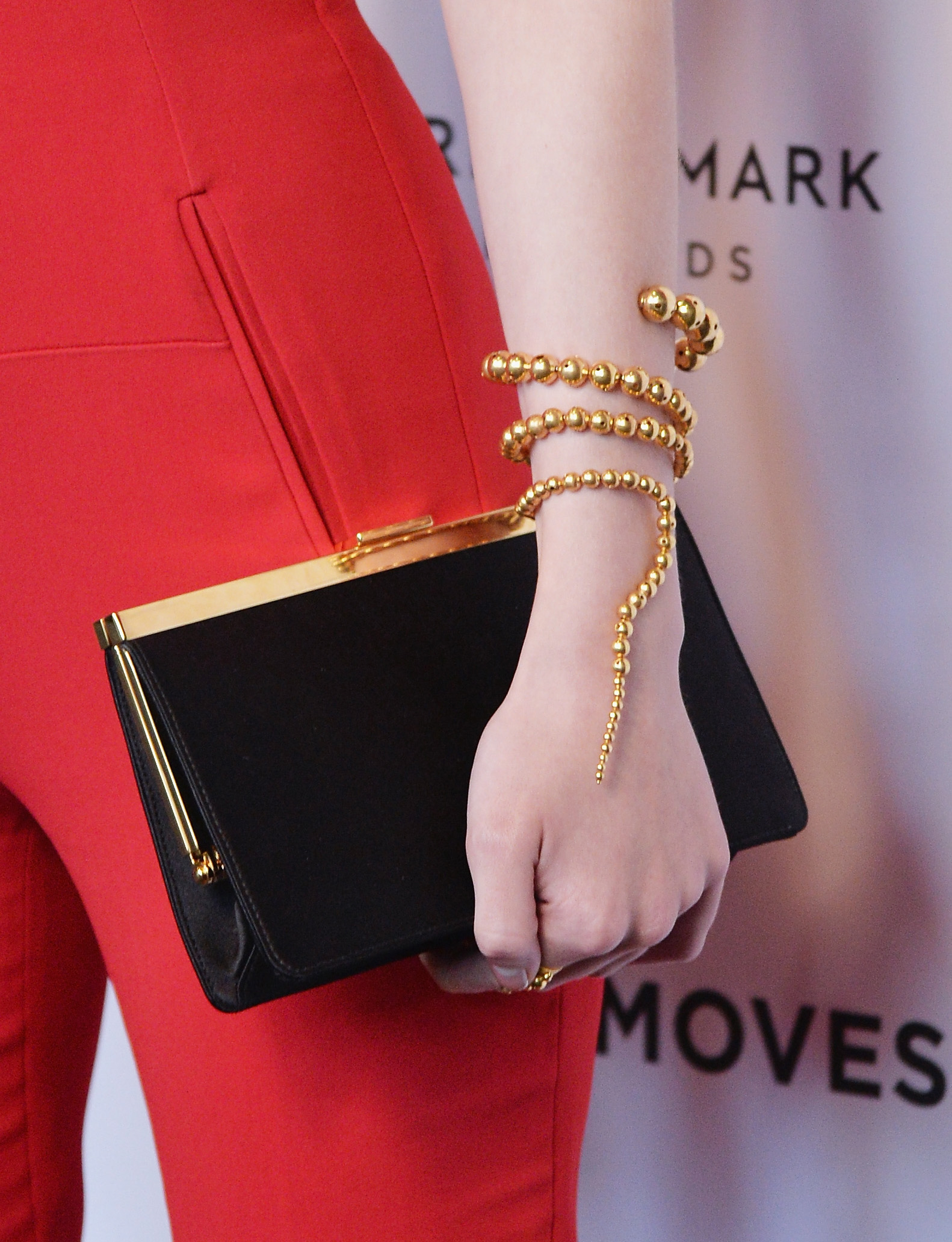 Dakota Fanning New York premiere of her new movie Night Moves wearing a red jumpsuit